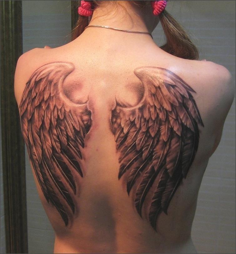 Фото тату на пояснице с крыльями